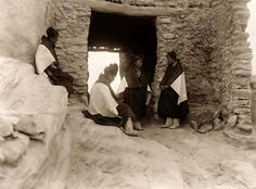 Modest Hopi Indian Maidens. It was made in 1906 by Edward S. Curtis.    The illustration documents Four young Hopi women gathered outside of an entrance to an adobe building.