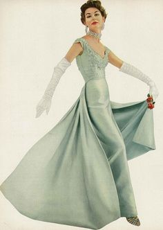 November Vogue 1953 by Roger Prigent. Love the dress, but not a fan of the gloves