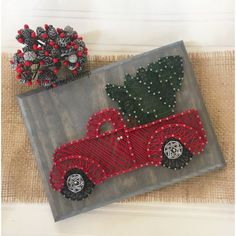 Bring in a little Christmas cheer with this adorable string art Christmas tree truck. Measures 7x9 inches.  Stain and string color can be customized.