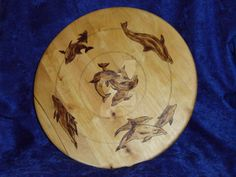 Dolphin Lazy Susan by CapturedMuseArt on DeviantArt Woodburning / Pyrography  Request custom art like this at https://www.etsy.com/shop/capturedmuse !