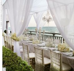 Dinner took place beneath oceanfront cabanas draped with gauzy white fabric and decorated with romantic crystal chandeliers.