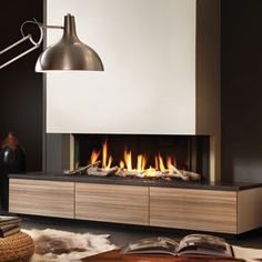 Trends - Dru Gas Fireplace PowerVent in a Modern Design Living Room with the Cutest Cow Hocker! Inset Fireplace, Fireplace Feature Wall, Small Fireplace, Home Fireplace, Fireplace Design, Fireplace Ideas, Contemporary Home Decor, Modern Interior Design, Contemporary Fireplaces