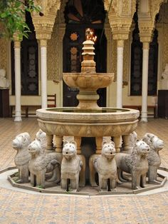 Lion fountain in the Court of the Lions, Palace of Alhambra, Granada, Spain