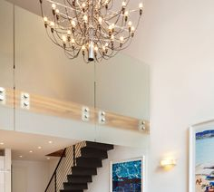 Sandblasted Glass Railing And Mid Century Traditional Flos Model Chandelier Design Ideas: Colourful and Light-Filled Duplex in Manhattan by Axis Mundi Design Sandblasted Glass, Glass Railing, Manhattan, Chandelier, Mid Century, Design Ideas, Ceiling Lights, Traditional, Model