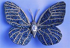 //Titanium butterfly brooch set with diamonds and sapphires....