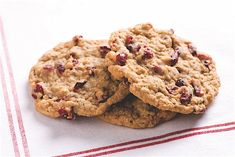 These holiday cookies are great for office parties and as gifts. Vary them with dried cherries and chocolate chips.