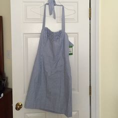Lilly seersucker dress Lilly Pulitzer seersucker halter dress. This dress is very fitted and runs small. So small that I tore it trying to put it on. The tear is on the seam and can easily be fixed but I can't in good conscience return it to the store. I can provide more pics of the tear if needed. It is a very cute summer dress and I am heartbroken that it didn't fit. Lilly Pulitzer Dresses
