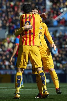 Luis Suarez of Barcelona celebrates scoring his team's second goal with his teammate Lionel Messi during the La Liga match between Levante UD and FC Barcelona at Ciutat de Valencia on February 07, 2016 in Valencia
