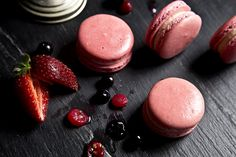 Macaron with mousseline made of blackberry, raspberry, blueberry and cranberry.