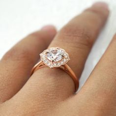 This lovely engagement ring features a round brilliant cut diamond in the center of a floral halo of bright cut set diamonds, all atop a tapered rose gold shank. JosephJewelry.com | Designed and created by Joseph Jewelry | Seattle, WA | Bellevue, WA | Online | Design Your Own Unique Engagement Ring | #engagementring Pink And Gold, White Gold, Rose Gold, Halo Diamond Engagement Ring, Engagement Rings, Gemstone Colors, Shank, Diamond Cuts, Joseph