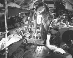 A C-46 Commando full of wounded serviceman being evacuated by a flighing nurse from Manila, 1945 ~