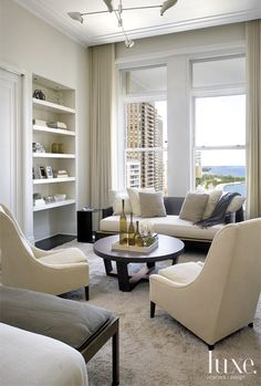 Nice arrangement of chairs. Get the cosy cuddling and the reading chairs. ? Wall mounted tv within the bookcase?