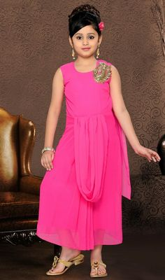 Rose pink shade faux georgette gown flaunts beads, zardosi and sparkling stones decked bold applique decked to one side of the shoulder part. Pleated style lower torso adorns the overall looks. #PrettyPinkAnkleLengthGown