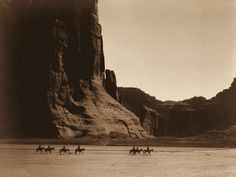 Group of men of the Navajo tribe in the Canyon de Chelly, Arizona, 1904. Edward S. Curtis. Native American photographs