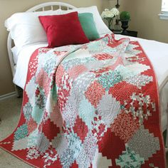 This traditional Courthouse Steps quilt design in a Chinese Lanterns arrangement is a cheerful addition to your holiday décor or gift making. The Holiday Lanterns lap quilt pattern requires careful fabric placement, but the sewing is simple.