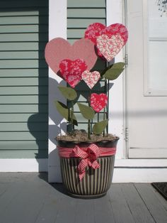 A pot of fabric-covered hearts for indoors or outdoors ~ cardboard or foam core for hearts. Possibilities....