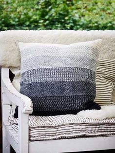 Striped Cushion in tunisian crochet moss stitch. Design by Pernille Cordes