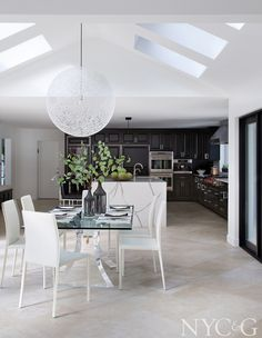 Contemporary Gold Coast dining room, large white sphere pendant, vaulted ceiling by Abaca Interiors Vaulted Ceiling Decor, Vaulted Ceilings, Kitchen Stools, Kitchen Interior, Kitchen Design, Room Paint, Interiores Design, Storage Spaces, Home Furnishings