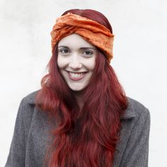 Channel the seventies gloss trend with this chic turban headband. Autumn ready rust orange crushed velvet is hand stitched by Sophie in her Cornish studio and finished with an adjustable twist....