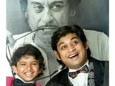 A picture of brothers Sumeet Kumar and Amit Kumar shot against a picture of their late father and legendary singer Kishore Kumar. Bollywood Gossip, Bollywood Actors, Indian Idol, Kishore Kumar, Film Song, Legendary Singers, Music Composers, Gossip News, News India