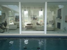 My grandmother's living room is past the pool and mirrors... on the left side is the door and kitchen... simple and elegant