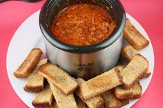 Crockpot Pizza Fondue - We make it without the pepperoni, but if you do use pepperoni I would reccomend the mini ones....and if you use high-moisture mozzarella that makes it even better!