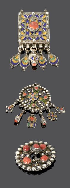 Algeria - Grand Kabylie   Two pendants and one fibula from the Beni Yenni people; silver, enamel and coral.   273€ ~ sold (May '15)