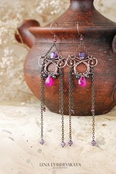 "A collection of ""Vathek"" Earrings ""RAIHAN"" Chalcedony, amethyst, black pearl, garnet, tourmaline, copper"