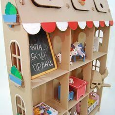 Cardboard shelves plus dolls house