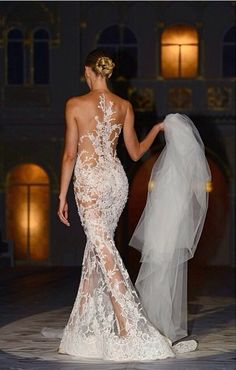 Pronovias 2015 - If this is a wedding dress and veil, so much for ANY modesty! And, I love that it's WHITE!!