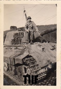 A American GI posing on a abandoned King Tiger