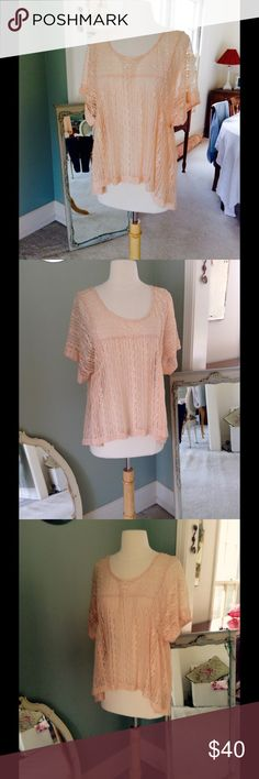 Free People Top Very dainty and pretty on! Great with a white or skin coloredk Cami and hangs so nicely. Peach color. Free People Tops