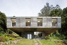 Like a grand concrete monolith being elevated out from the steep hillside, Guna House in Llacolen, Chile, is a private residence designed by Mauricio Pezo and Sofia von Ellrichshausen from architecture studio Pezo von Ellrichshausen. Concrete Architecture, Residential Architecture, Amazing Architecture, Interior Architecture, Architecture Panel, Architecture Portfolio, San Pedro, Pezo Von Ellrichshausen, Casas Containers