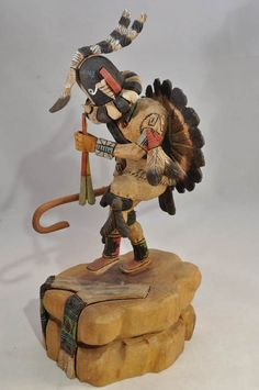 """Hopi Kachina - Kokopelli with Sunface feather bustle 9"""" overall including 2"""" carved base by Milton Howard  Hand Carved and Painted Cottonwood Root Great detail Hopi Kachina - Kokopelli with Unusual feather bustle 9"""" overall including 2"""" carved base  $895.00. AAIA, Inc. deals in antique & contemporary Native American Indian art and artifacts. We Buy, Sell, Consign, Appraise, Restore & Research. #Antique #American #Indian #Art (949) 813-7202 mwindianart@gmail.com"""