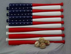 American flag made with 13 33 inch wood baseball bat halves. The flag measures approximately inches. The 50 stars are vinyl decals. Ready to hang on the wall with 1 screw or nail in the wall. Please visit my Etsy shop to see my other bat creations. Baseball Bat Flag, Baseball Crafts, Cubs Baseball, Baseball Cookies, Baseball Stuff, Vintage Baseball Room, Bat Craft, Flag Shop, Be Natural
