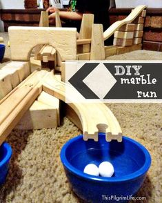 DIY marble run with wood train tracks and wooden blocks {This Pilgrim Life} Train Activities, Fun Activities For Kids, Wooden Marble Run, Marble Runs, Marble Tracks, Marble Machine, Marble Games, Wooden Train, Business For Kids
