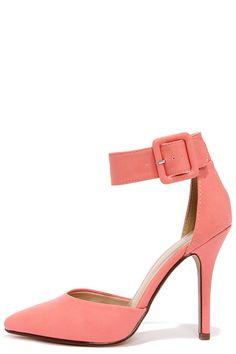 """Every single step you take will be ten times sexier in these single strap stilettos! The My Delicious Aveta Salmon Ankle Strap Heels are your answer to any special occasion in coral pink matte vegan leather with a pointed toe, split upper, and a wide buckled ankle strap. 4.25"""" wrapped stiletto heel meets a single sole. Cushioned insole. Rubber sole has nonskid markings. Available in whole and half sizes. Fit is true to size. Measurements are for a size 6. All vegan friendly, man made mat..."""