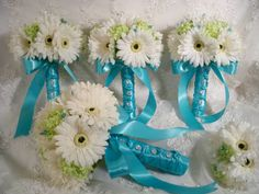 Possible for bridesmaid's bouquets - white daisies, colored ribbon (opposite of their dress color...or all orange ribbon?)