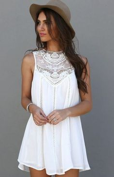 White summer dress with lace detail.