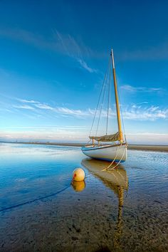 """peaceful"". Boat on the shore of the sea. Beautiful colors in this Amazing photography"