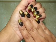 Black & Gold Nail art. This was done on my miracle nail mat. I've been doing my nail art on this mat and they have come out spectacular! I'm trying not to get hooked on using my nail mat but I am.