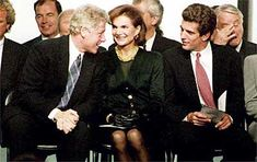 President Bill Clinton talking with Jacqueline Kennedy Onassis and John Kennedy Jr. on October 29,1993 during the opening ceremonies for the newly redesigned John F. Kennedy Library in Boston.