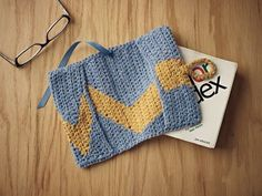 Reversible Intarsia Book Cozy by Laurinda Reddig Accessorize your books with this fun crochet book cover.
