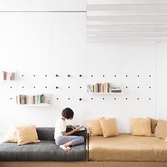 Architect Silvia Allori has overhauled her 1970s Florentine flat into a space for work and living. Just as our Peggy Peg Boards are a practical way to make use of precious wall space Silvia uses pegs and mounted shelves as both an aesthetic feature and storage solution. #plyroom #plyroomsimplicity #plywood #inspired #architecture #interiordesign #interiordecorating #scandinavian #minimalist #italian #shibui #naturallight #woodwork