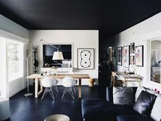 It takes a bit of daring to paint a ceiling black; if we lived in a space with lofty ceilings and intricate mouldings, we'd be tempted.
