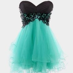 perfect homecoming dress. short strapless sea foam green tulle with black detailed bust