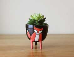 PLEASE NOTE: Processing time is about 4 weeks.  A cute fox planter in coral red, white and black. This container works perfectly for small plants and
