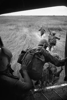 Vietnam 1963: South Vietnamese troops land in the Mekong Delta, near Tan Hung Dong. Photo by Rene Burri/Magnum Photos.