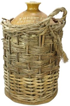 T. H. Mate & Co., Wine & Spirit Merchants, Albury. Impressed 2 gallon stoneware demijohn. original wicker basket. c1890s. ABCR Auction 18 Lot 398. November 2014