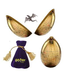 Harry Potter inscribed, golden egg with a tiny dragon inside.